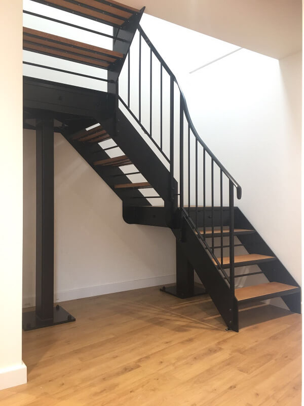 Internal metal staircase with oak treads